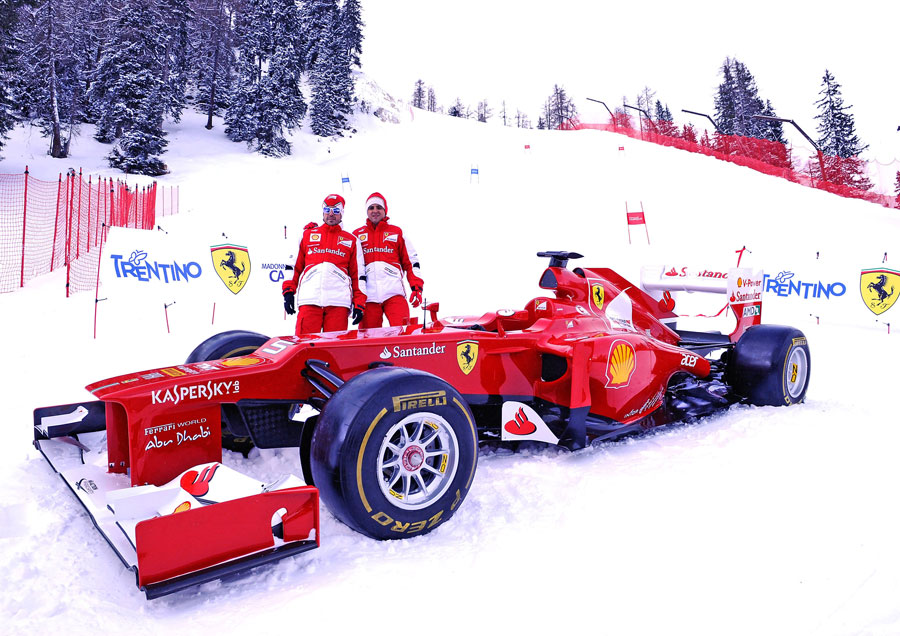 Fernando Alonso and Felipe Massa with an F2012 at the opening of a new piste