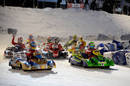 Fernando Alonso and Felipe Massa lead the field away in the Ferrari ice race