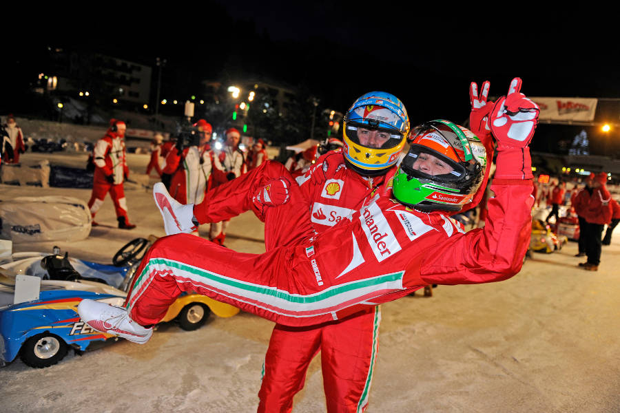Fernando Alonso holds up Giancarlo Fisichella after the Ferrari ice race