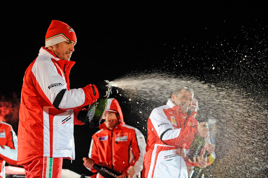 Fernando Alonso celebrates his victory in the Ferrari ice race
