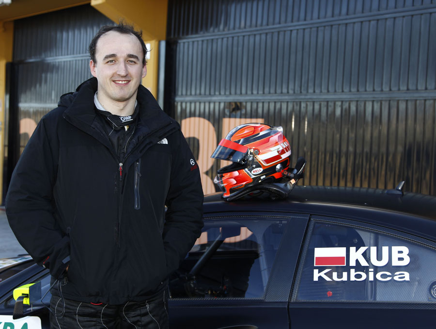 Robert Kubica poses for a photo ahead of his first DTM test