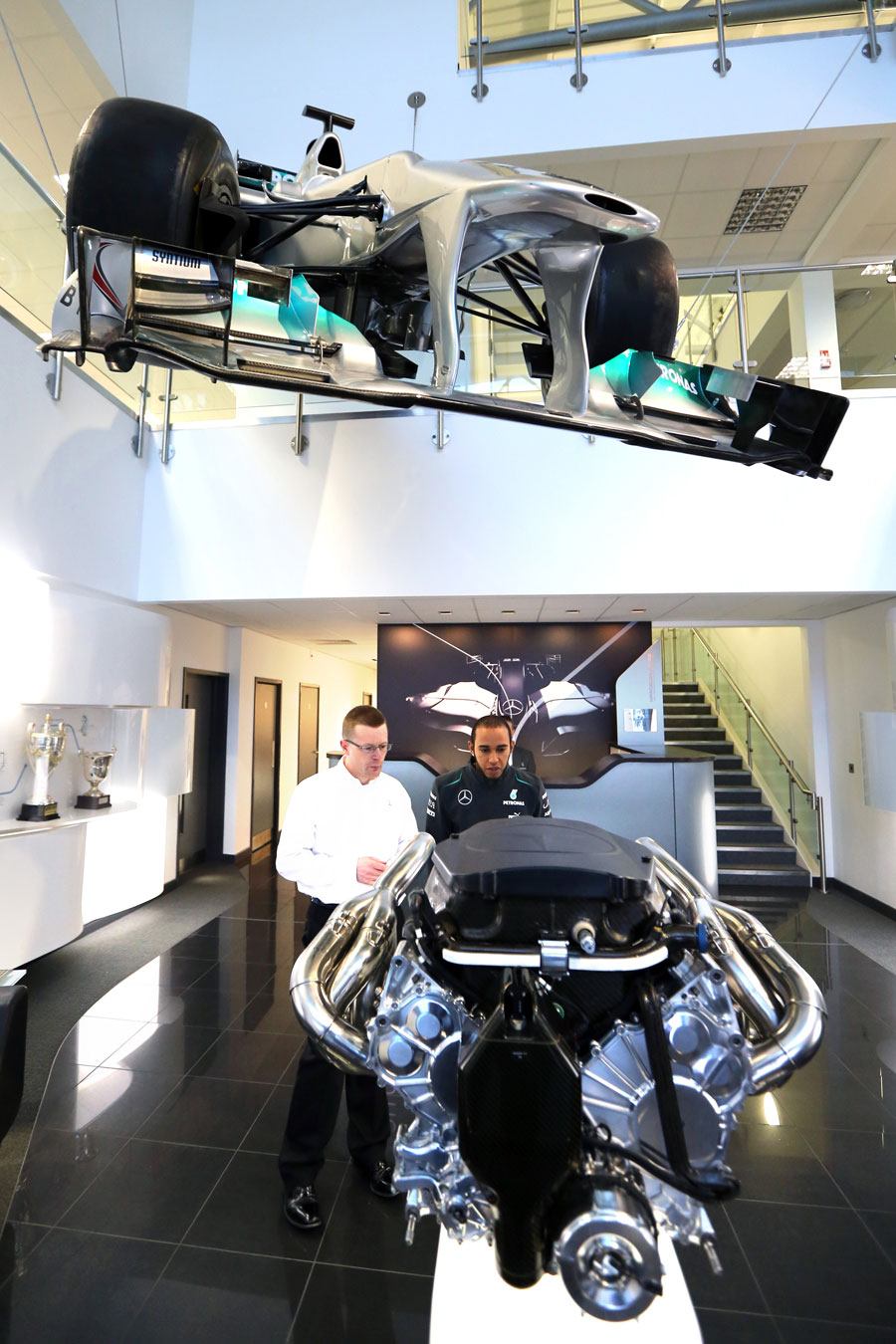 Lewis Hamilton takes a closer look at a Mercedes engine