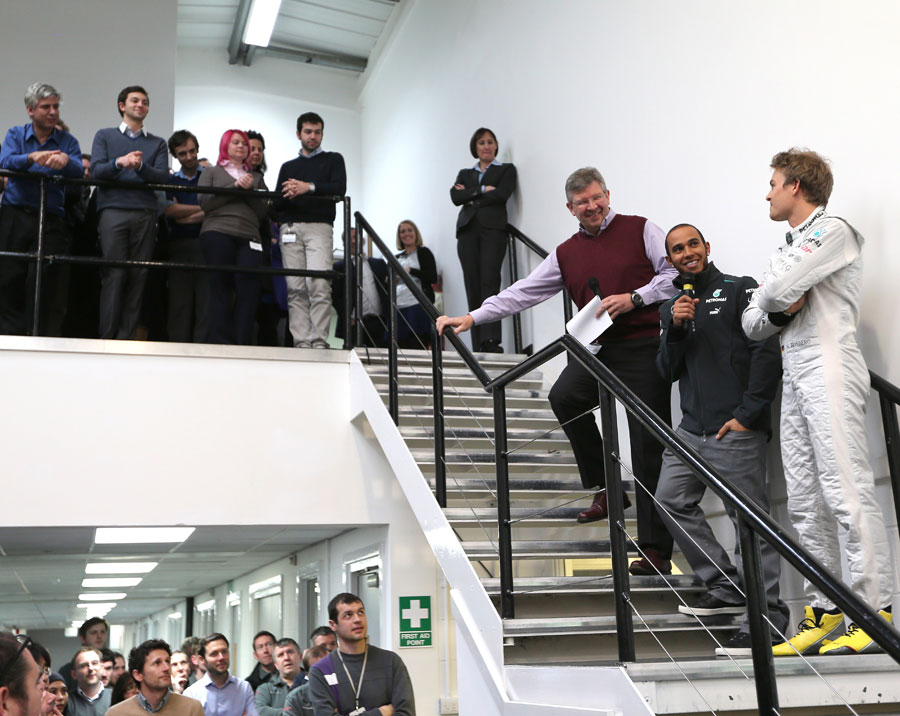 Lewis Hamilton, Ross Brawn and Nico Rosberg address the workforce at the Mercedes factory