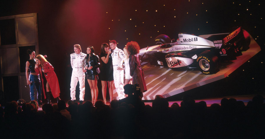 The Spice Girls join David Coulthard and Mika Hakkinen on stage for the launch of the McLaren MP4-12