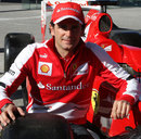 Pedro de la Rosa poses with a Ferrari during a Santander event