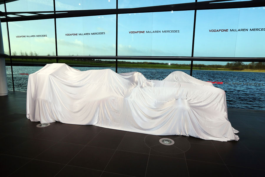 The new McLaren MP4-28 under wraps ahead of its launch