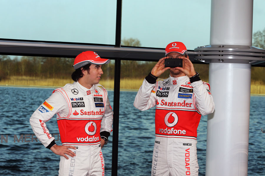 Jenson Button takes a photo at the launch of the McLaren MP4-28