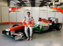 Paul di Resta poses for a photo with the new Force India VJM06