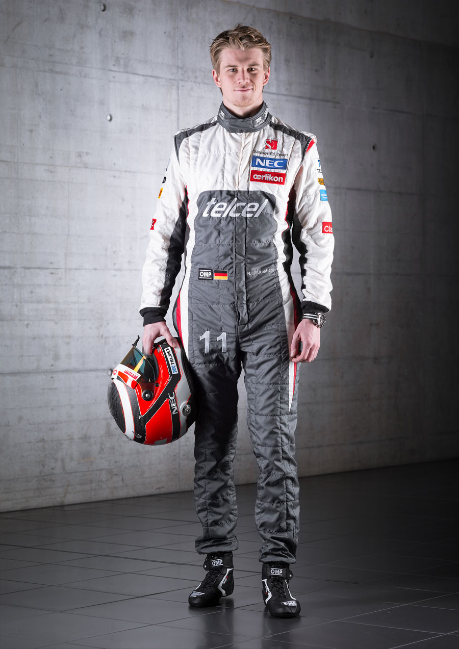 Nico Hulkenberg poses for a photo in his new Sauber overalls