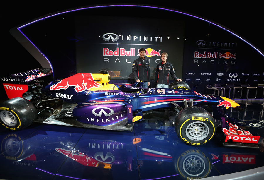 Sebastian Vettel and Mark Webber pose with the Red Bull RB9