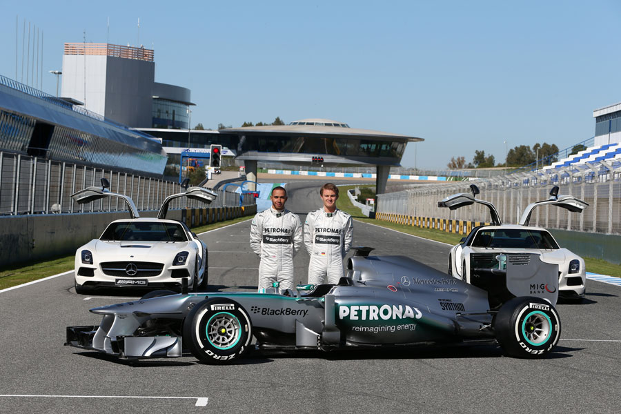 Nico Rosberg and Lewis Hamilton pose with the new Mercedes W04