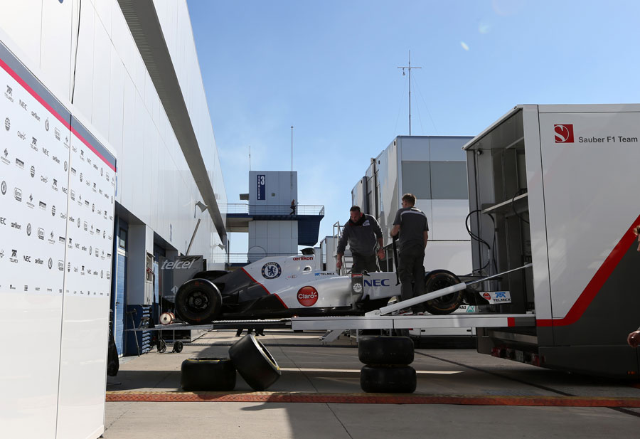 A Sauber C31 is unloaded from the team transporter