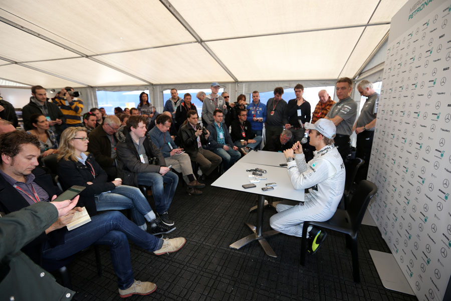 Nico Rosberg addresses the media after his first run in the Mercedes W04