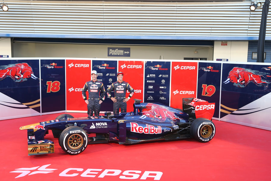 Jean-Eric Vergne and Daniel Ricciardo with the new Toro Rosso STR8 in the Jerez pit lane