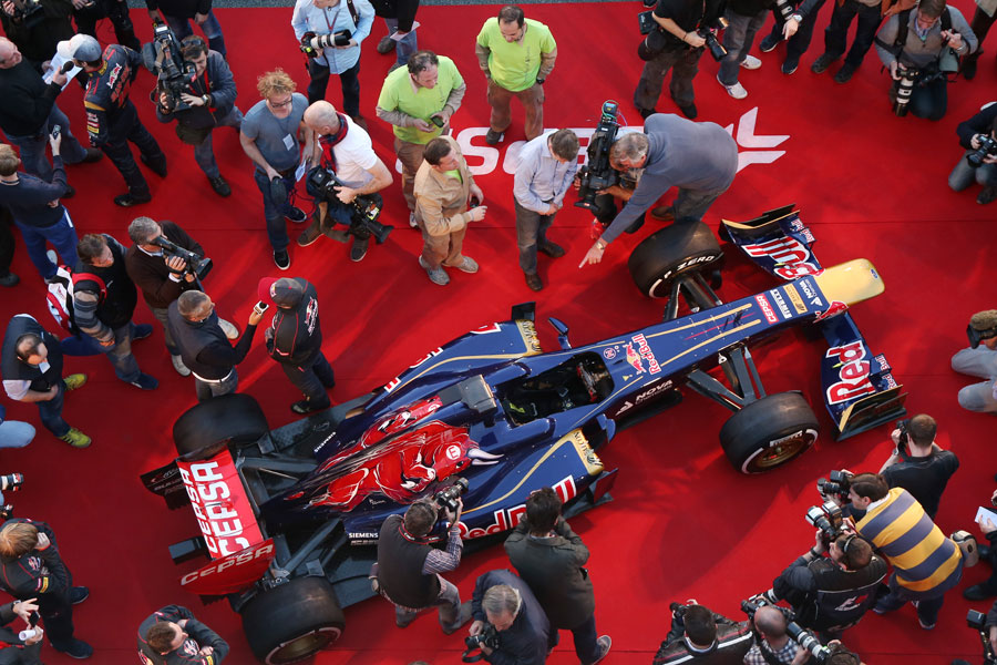 Media and photographers surround the new Toro Rosso STR8