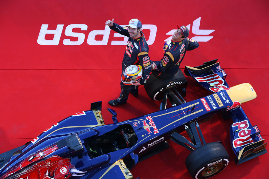 Jean-Eric Vergne and Daniel Ricciardo wave to photographers during the launch of the Toro Rosso STR8