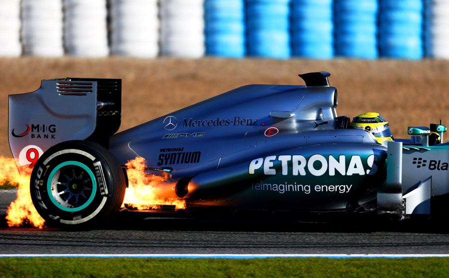 Flames burst out of the rear of Nico Rosberg's W04