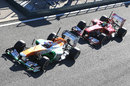 Felipe Massa follows Paul di Resta out on track