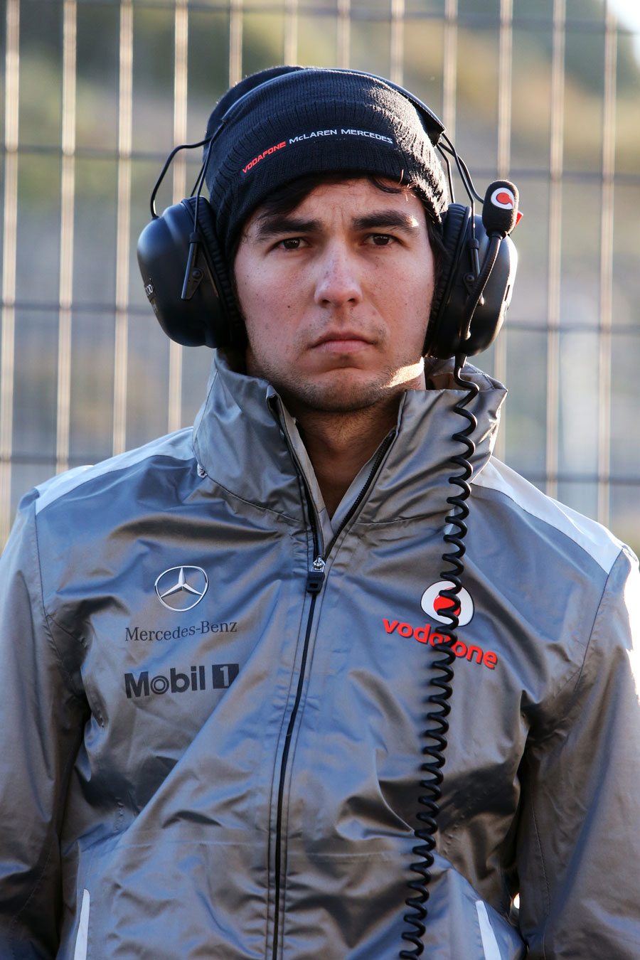 Sergio Perez watches on from the McLaren pit wall