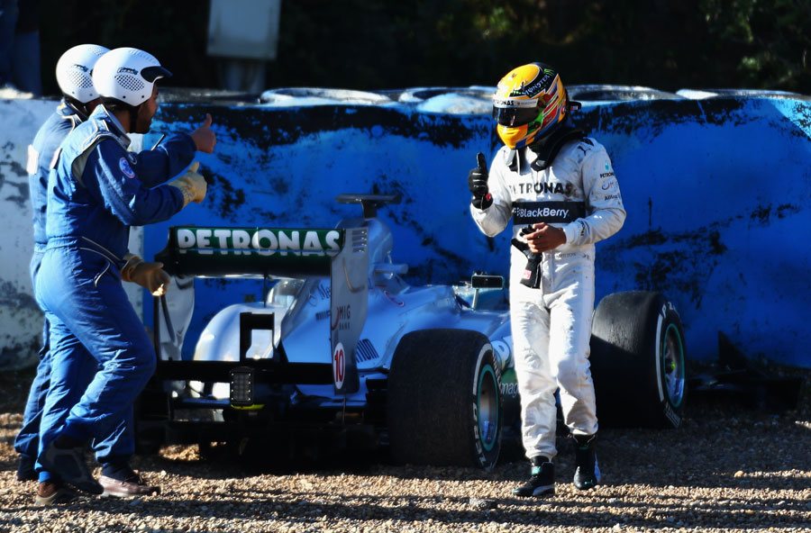 Lewis Hamilton gives the thumbs up after crashing at turn six