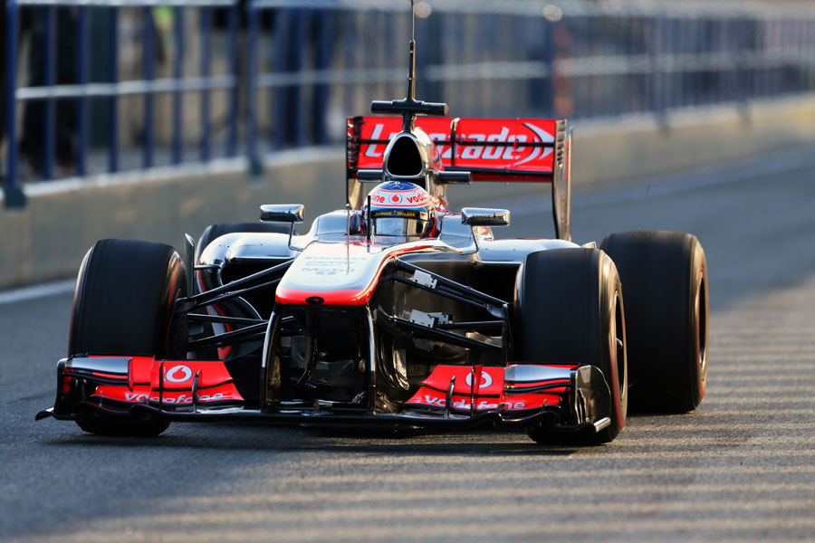Jenson Button rolls down the pit lane ahead of another run