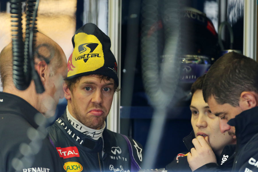 Sebastian Vettel talks with Adrian Newey and his engineers