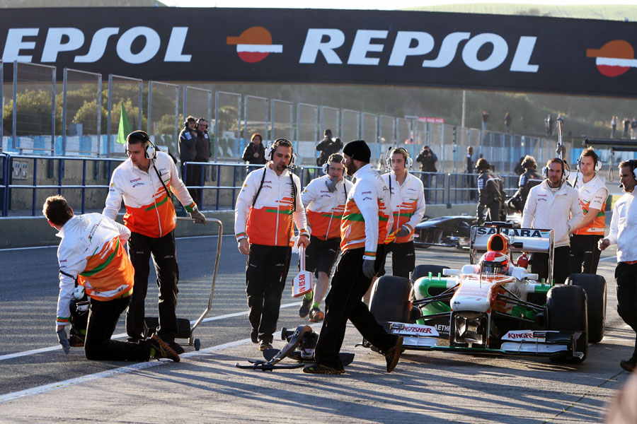 A Force India mechanic recovers after being hit by James Rossiter's Force India