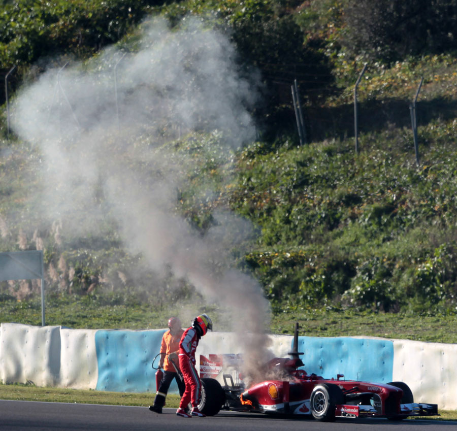 Pedro de la Rosa scrambles clear of his smoking Ferrari