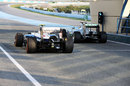 Valtteri Bottas passes Lewis Hamilton in the pit lane