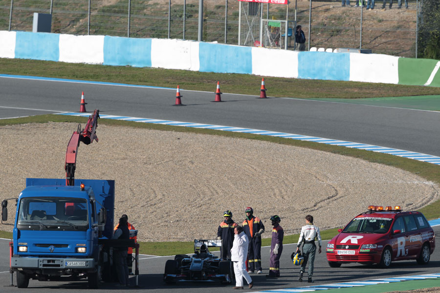 Esteban Gutierrez's Sauber is recovered after running out of fuel