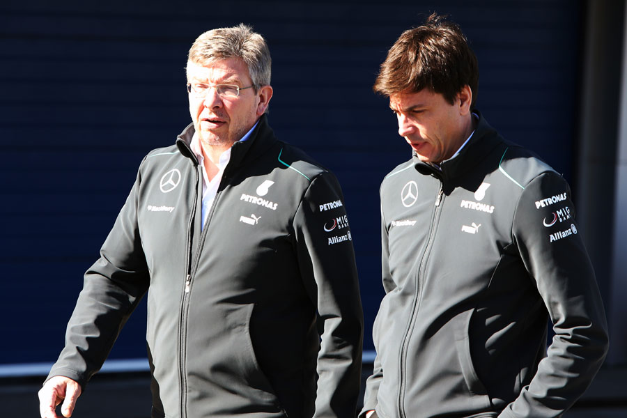 Mercedes bosses Ross Brawn and Toto Wolff walk through the paddock