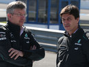 Mercedes bosses Ross Brawn and Toto Wolff talk in the paddock