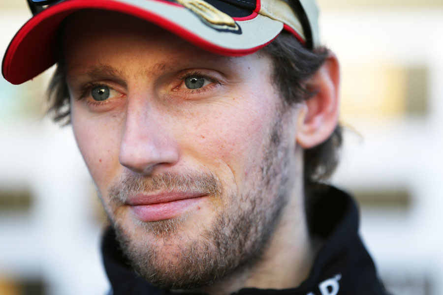 Romain Grosjean talks to the press