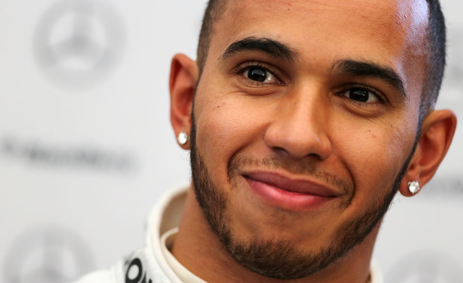 Lewis Hamilton talks to the press