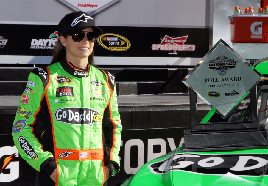 Danica Patrick poses after securing pole at the NASCAR Sprint Cup Series Daytona 500