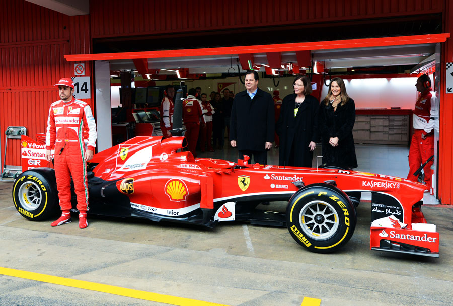 Fernando Alonso poses for a photo alongside Ferrari's new sponsors UPS