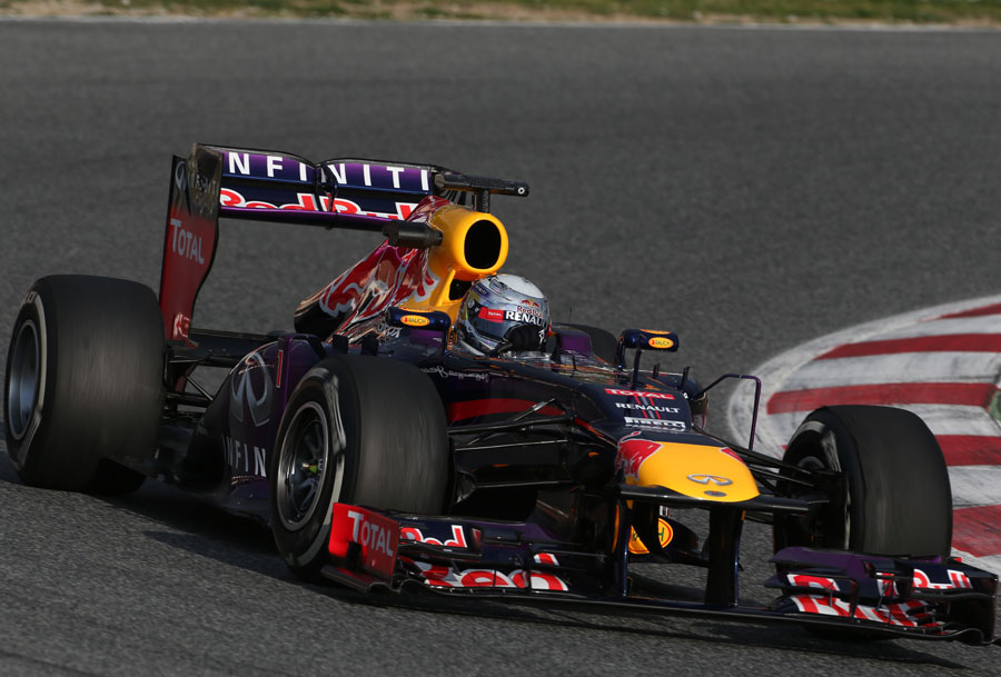 Sebastian Vettel on track in the Red Bull RB9