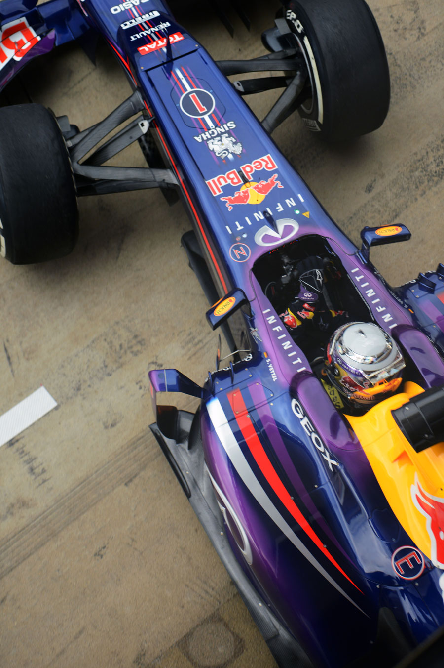 Sebastian Vettel leaves the Red Bull garage in the RB9