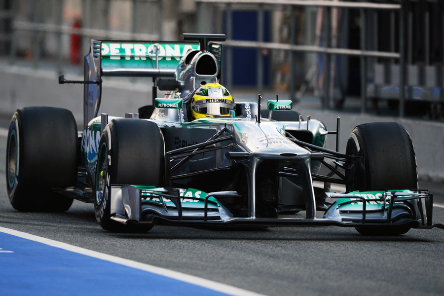 Nico Rosberg heads down the pit lane with aero-measuring equipment on his Mercedes