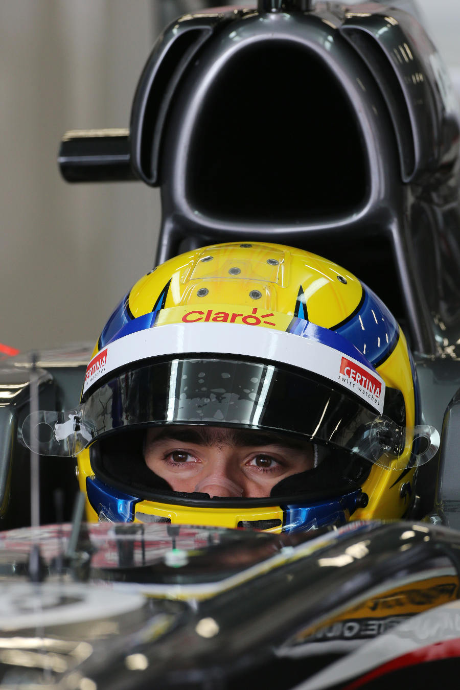 Esteban Gutierrez waits in the cockpit of the Sauber C32