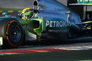 Lewis Hamilton on track in a Mercedes doused in aero paint