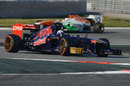 Daniel Ricciardo leads Paul di Resta on track