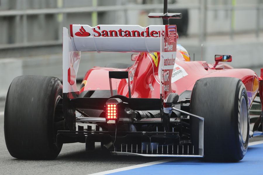 Fernando Alonso heads out on track with a measuring device attached to the Ferrari's diffuser