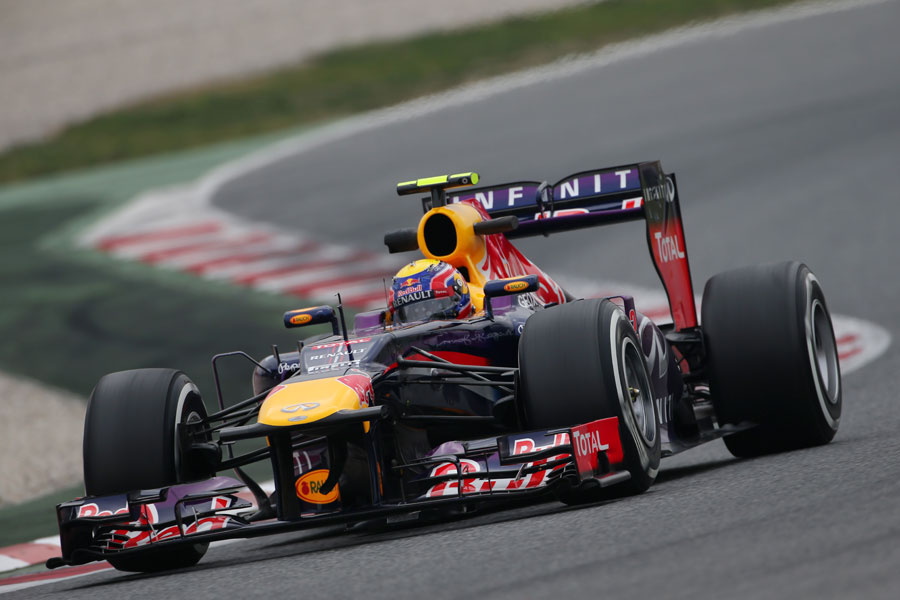 Mark Webber attacks the Barcelona circuit in the Red Bull