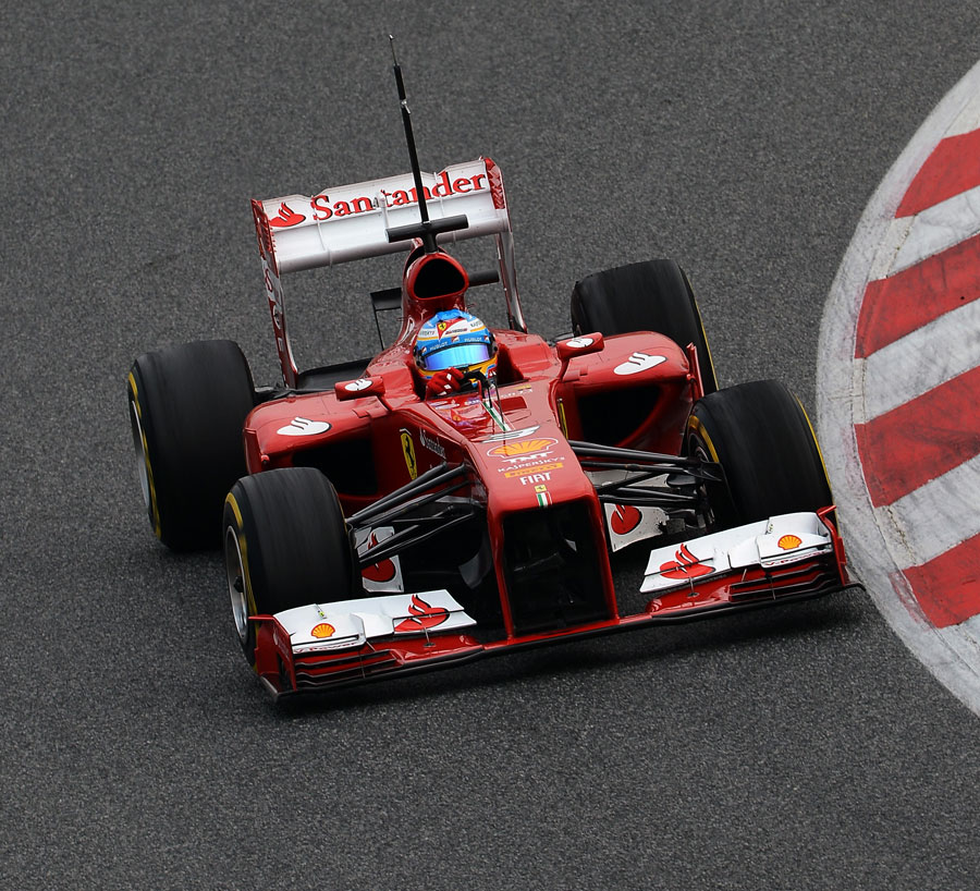 Fernando Alonso tackles the Catalunya circuit in the Ferrari