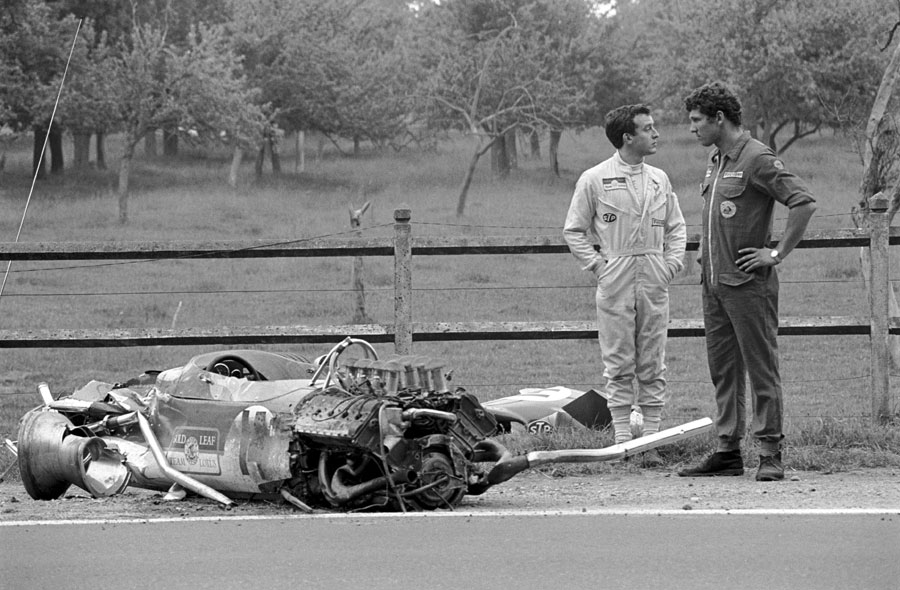 Jackie Oliver reflects on how he managed to survive a 140mph crash as he stands next to the mangled remains of his Lotus