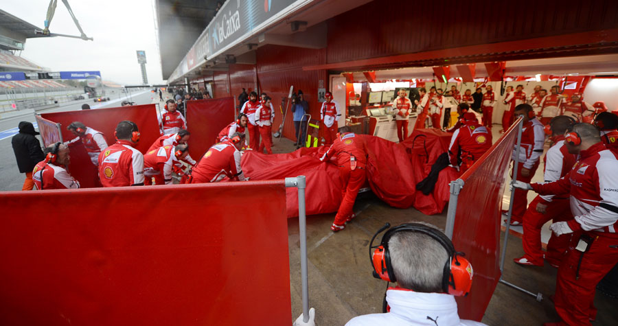 Felipe Massa's Ferrari being brought home after sliding off