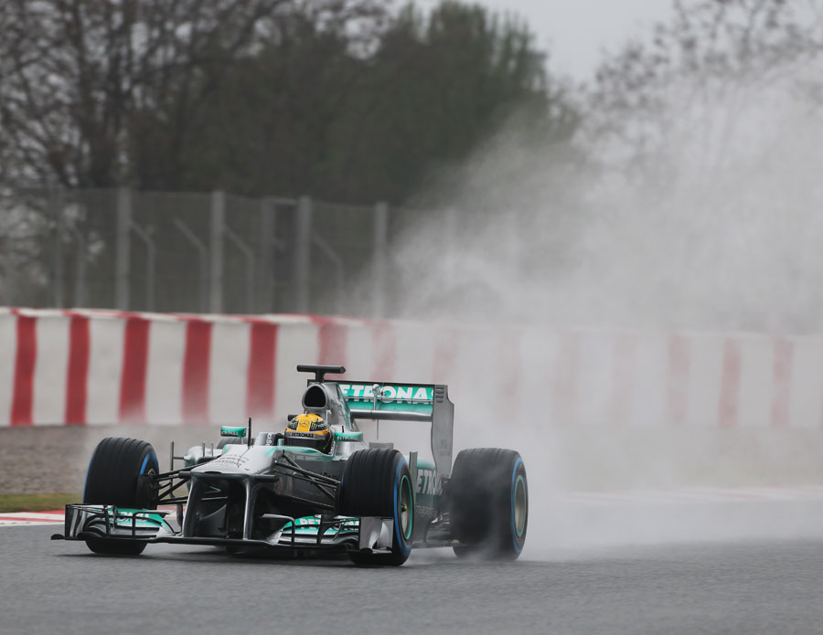 Lewis Hamilton uses full wet tyres to combat the conditions