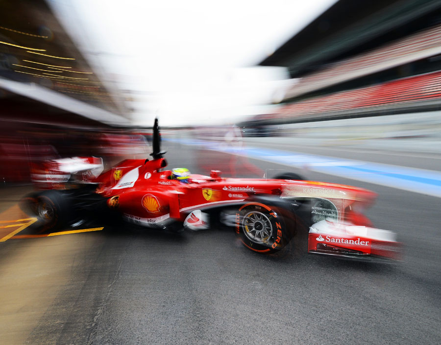 Felipe Massa leaves the Ferrari garage