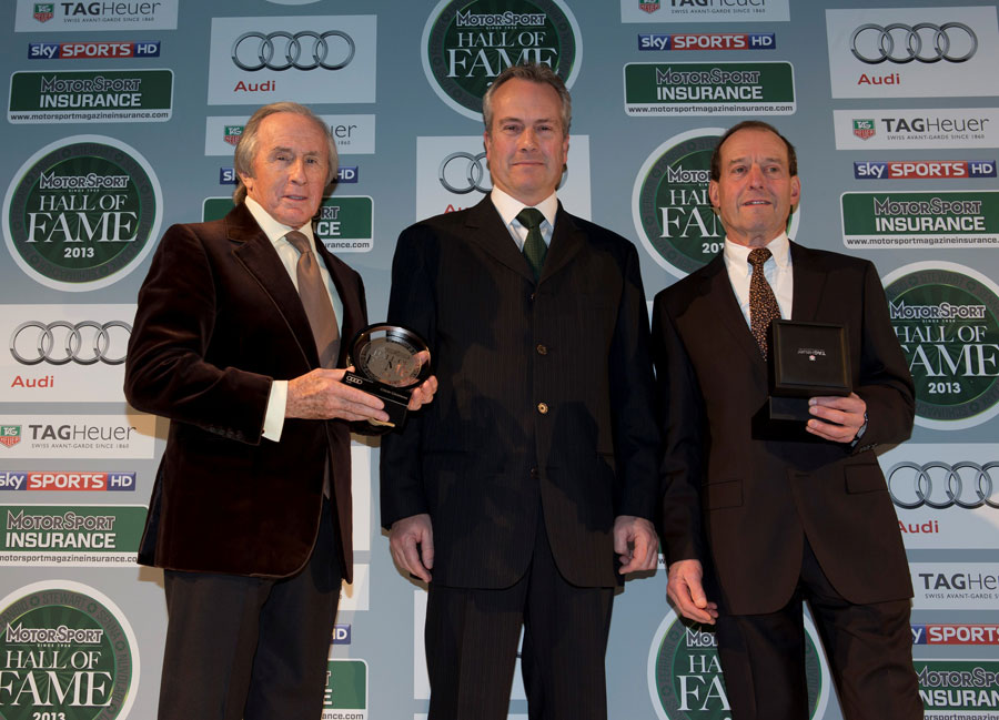 Clive Chapman receives the award in honour of his father, Clive, from Sir Jackie Stewart and Jackie Oliver